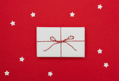 Above view of gift package on red background Stock Image