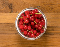 From above view of glass bowl of redcurrant fruit Royalty Free Stock Photography