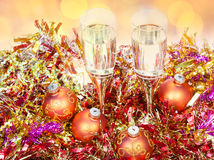 Above view glasses, gold Xmass balls on tinsel Stock Photo