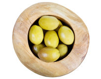 Above view of green olives in wooden bowl isolated royalty free stock photos