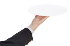 Above view of hand with empty flat white plate Royalty Free Stock Images