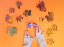Above view at hands holding Great Britain flag Stock Photography