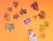 Above view at hands holding Great Britain flag Royalty Free Stock Images