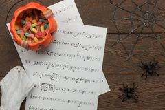 Above view of Happy Halloween Festival and music note sheet background concept. stock photo
