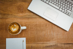 Above view of a laptop and a coffee Royalty Free Stock Image