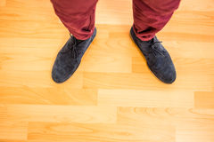 Above view of a man with black shoes. On wooden park Stock Images