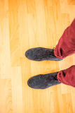 Above view of a man with black shoes. On wooden plank Stock Image