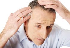 Above view of a man examining his hair stock photos