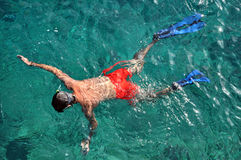 Above view of man snorkeling in the sea Stock Photos