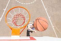 Above View of Man Tossing Basketball into Hoop Royalty Free Stock Images