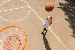 Above View of Man Tossing Basketball into Hoop Stock Photos