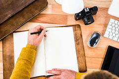 Above view of man writing on notebook Royalty Free Stock Photography