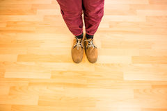 Above view of a man with yellow shoes. On wooden park Royalty Free Stock Photos