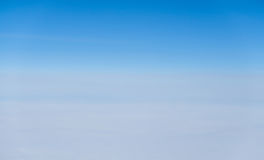 Above view many little clouds in blue sky from airplane Stock Image