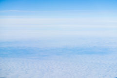 Above view many little clouds in blue sky from airplane Stock Photo