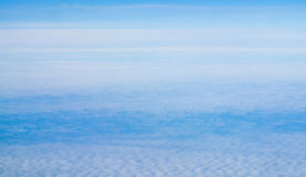 Above view many little clouds in blue sky from airplane Stock Photography