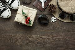 Above view of ornaments and decorations Merry Christmas and Happy New Year with accessory. To travel concept background.several sign item on modern rustic home Royalty Free Stock Images
