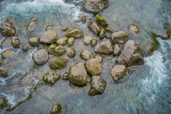 Above view of Petrohue River flowing through rocks in Llanquihue Province, Los Lagos Region, Chile.  royalty free stock photography