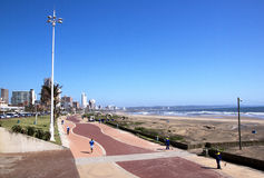 Above View of Promenade on Durban Beach Front. DURBAN< SOUTH AFRICA - DECEMBER 4< 2014 : Many unknown people 0n promenade amongst commercial and residential stock photos