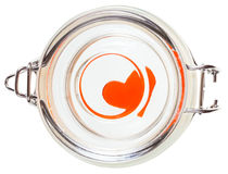 Above view of red toy heart in closed glass jar Royalty Free Stock Photos