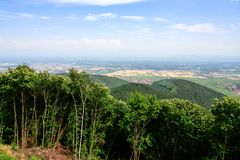 Above view of region Alsace Wine Route from Vosges. Travel to France - above view of region Alsace Wine Route in Vosges Mountains valley from green Black Forest Royalty Free Stock Photos