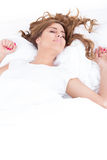 Above view of resting female under linen sheet with her long hai Stock Image