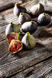 Above view of ripe figs on wooden table background Royalty Free Stock Images