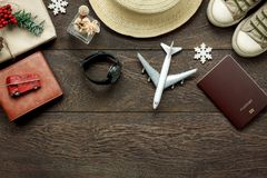 Above view shot of accessories fashion lifestyle to travel and Merry Christmas & Happy new year concept. Passport & clothes with many essential winter season Stock Image