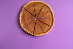 Above view of a sliced pumpkin pie. Homemade holiday dessert. royalty free stock photography