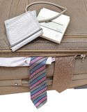 Above view of sphygmometer on suitcase with ties Royalty Free Stock Photo