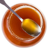 Above view of steel spoon on glass jar with honey Stock Photography