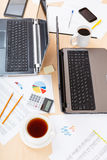 Above view of table with tools in modern office Royalty Free Stock Photo