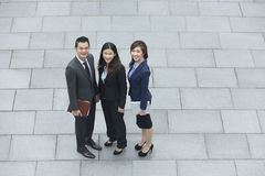 Above view of three Chinese Business colleagues. Royalty Free Stock Image