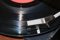 Above view of tonearm on vinyl record Stock Photos
