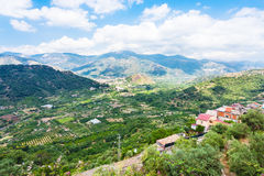 Above view of towns in mountain valley Stock Photography