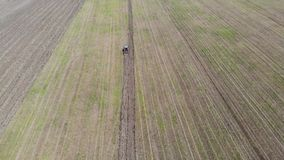 Above view of tractor plowing the field stock video