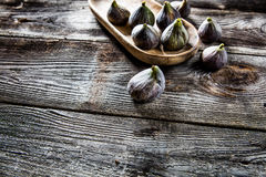 Above view of tray with fresh figs on wooden background Stock Image
