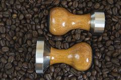 Above view on two tampers and coffee beans, close up Royalty Free Stock Photography