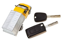 Above view of two vehicle keys and truck model Royalty Free Stock Photography