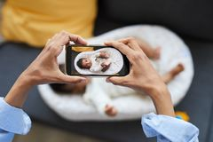 Photographing baby in cocoon stock images