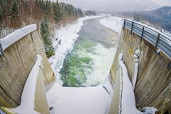 Above view of water reservoir with small dam. Small pile of snow and ice below the concrete dam. Location Hardangervidda. In Norway Royalty Free Stock Photos