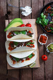 Above view of wheat wraps with mexican pork fajitas, selective focus. Close view Stock Image