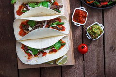 Above view of wheat wraps with mexican pork fajitas, selective focus. Close view Royalty Free Stock Photos