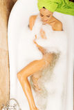 Above view of a woman relaxing in bath Stock Photos