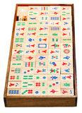 Above view of wood mahjong game tiles in box. Above view of set of wooden mahjong game tiles in box isolated on white background stock image