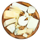 Above view of wooden plate with various cheeses royalty free stock photos