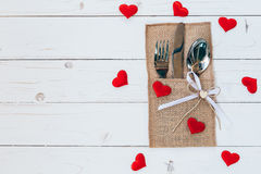 Above wood table set silverware and red heart for valentine day Stock Photography