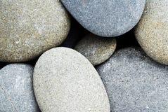 Abrégé sur arrondi roches Image stock
