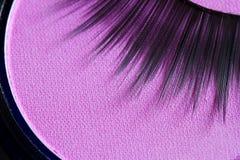 Abrégé sur cils et cosmétiques de fard à paupières Images stock