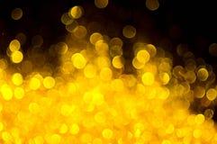 Abrégé sur couleur d'or de Bokeh Image libre de droits